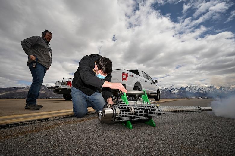 Tyler Adams, U.S. Department of Argriculture wildlife biologist, starts a bird fogger at Hill Air Force Base, Utah.