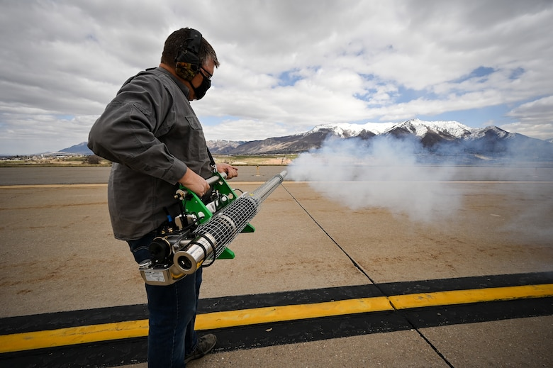 Ryan Carter, U.S. Department of Argriculture wildlife technician, operates a bird fogger at Hill Air Force Base, Utah.