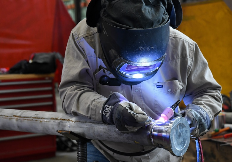Pipefitter Billy Joe Emberton places tack welds before completely welding a flange onto a section of pipe, March 4, 2021, at the Model Shop at Arnold Air Force Base, Tenn. April is National Welding Month. (U.S. Air Force photo by Jill Pickett)