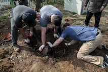 U.S. Marines with U.S. Marine Corps Forces – Korea remove a tree stump during a volunteer event at Sunrin Orphanage, Pohang, South Korea, March 13, 2021.