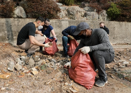 U.S. Marines with U.S. Marine Corps Forces – Korea removed rocks during a volunteer event at Sunrin Orphanage, Pohang, South Korea, March 13, 2021.