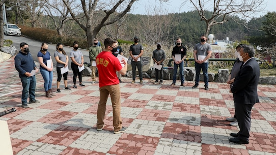 U.S. Marines with U.S. Marine Corps Forces – Korea received Certificates of Appreciation for removing tree stumps and rocks during a volunteer event at Sunrin Orphanage, Pohang, South Korea, March 13, 2021.