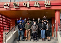 U.S. Marines with U.S. Marine Corps Forces – Korea pose with Mr. Park, Jung Min, Chief of Pohang Sunrin Orphanage, for a photo during a volunteer event at Sunrin Orphanage, Pohang, South Korea, March 13, 2021.