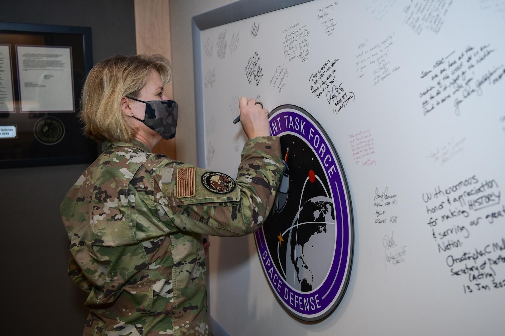 CFSCC leader signs board