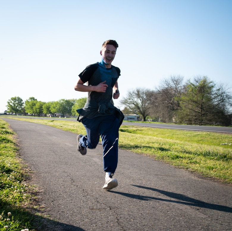 A participant in the Sexual Assault Awareness Month 5K run nears the halfway checkpoint at Barksdale Air Force Base, Louisiana, April 2, 2021.