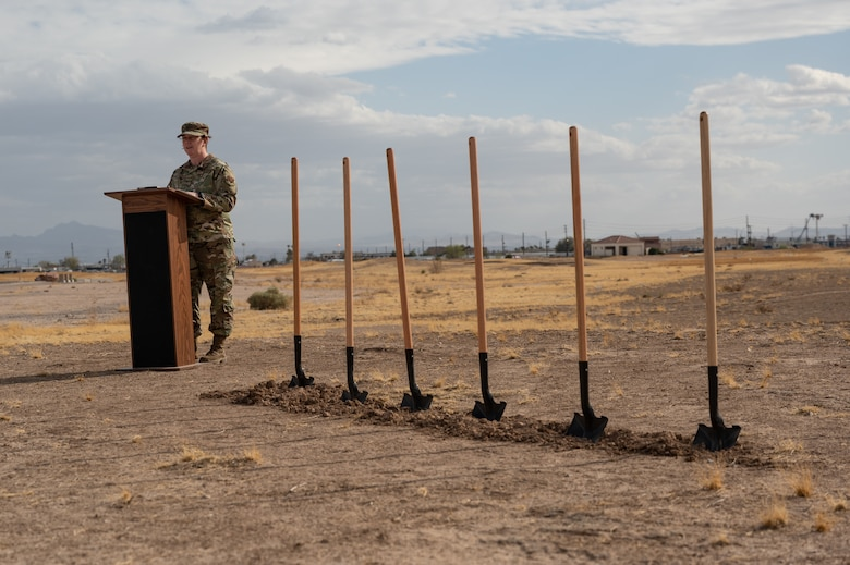 An Airman talking at a podium