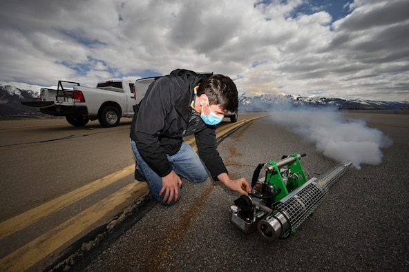 Tyler Adams, U.S. Department of Argriculture wildlife biologist, starts a bird fogger at Hill Air Force Base, Utah.