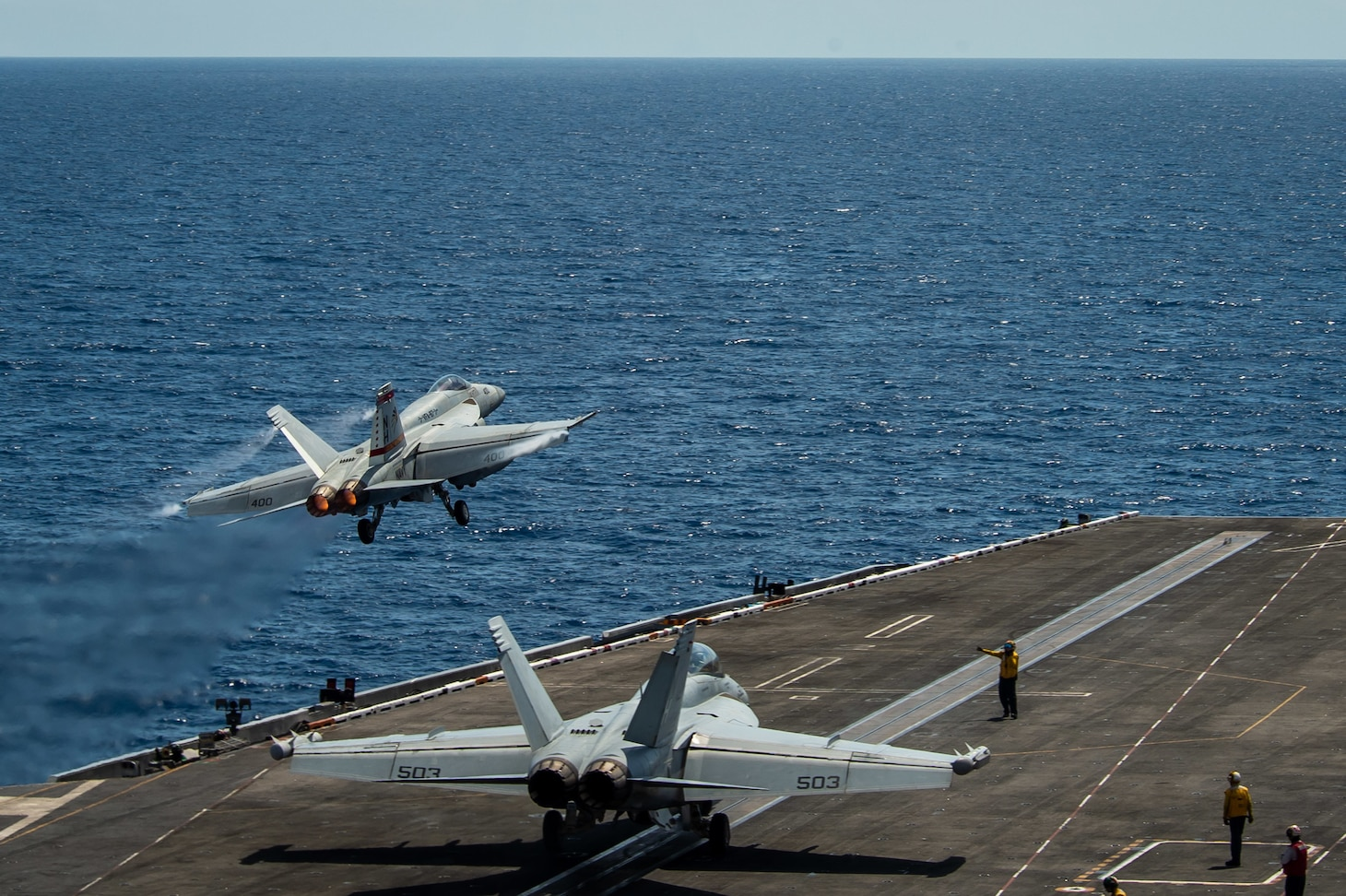 "SOUTH CHINA SEA (April 6, 2021) – An F/A-18E Super Hornet, assigned to the ""Golden Warriors"" of Strike Fighter Squadron (VFA) 87, launches from the flight deck of the aircraft carrier USS Theodore Roosevelt (CVN 71) April 6, 2021. The Theodore Roosevelt Carrier Strike Group is on a scheduled deployment to the U.S. 7th Fleet area of operations. As the U.S. Navy's largest forward-deployed fleet, 7th Fleet routinely operates and interacts with 35 maritime nations while conducting missions to preserve and protect a free and open Indo-Pacific Region."