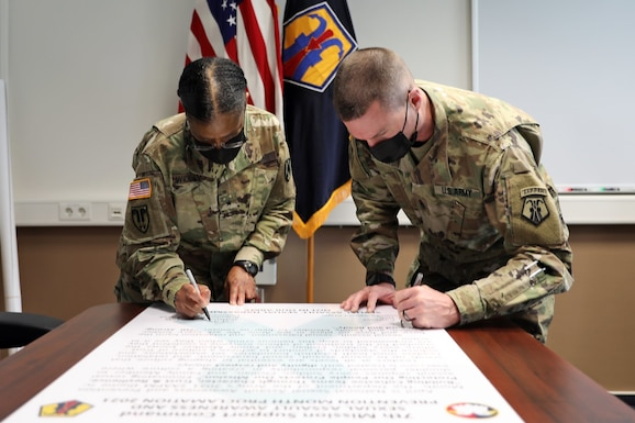 U.S. Army Reserve Brig. Gen. Wanda Williams, commander of the 7th Mission Support Command, and Command Sgt. Maj. Paul Yingst, 7th MSC command sergeant major, sign the 7th MSC Sexual Assault Awareness and Prevention Month Proclamation for 2021 in Kaiserslautern, Germany, March 31, 2021. Throughout the Army, April is Sexual Assault Awareness and Prevention Month, or SAAPM.