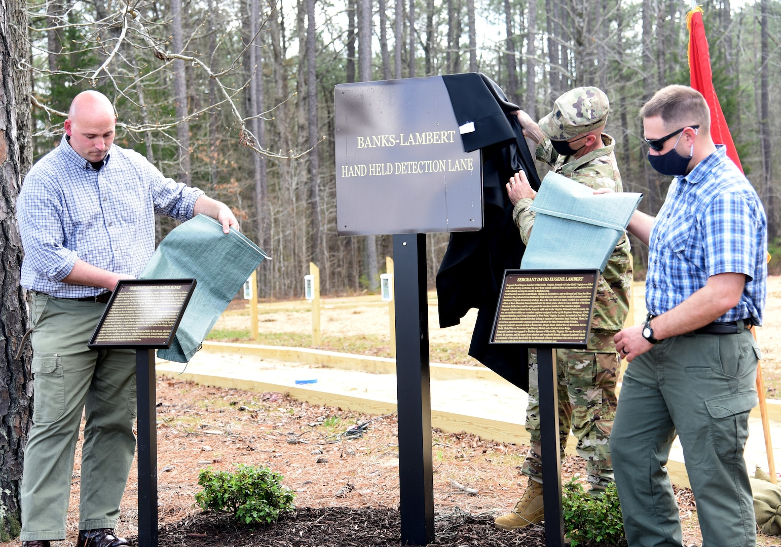 Current and former Virginia National Guard Soldiers and guests attend a dedication ceremony for the new Banks-Lambert Handheld Detection Lane March 26, 2021, at Fort Pickett, Virginia.