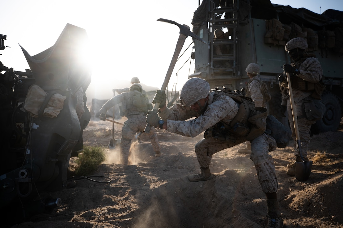 U.S. Marines dig an entrenchment at the Marine Corps Air Ground Combat Center in Twentynine Palms, Calif., March 30.