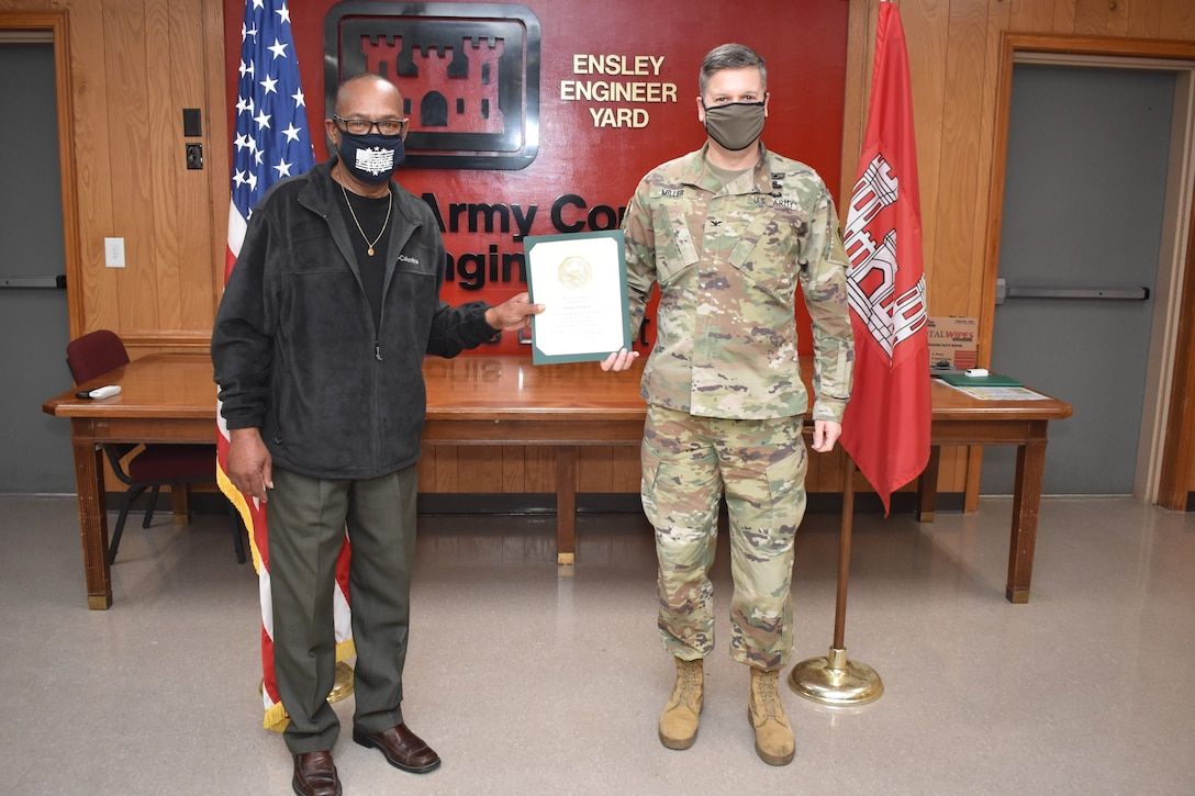 Memphis District Commander Col. Zachary Miller presents Heavy Mobile Equipment Mechanic Leader Robert Woods (left) with a service award on his 40 year anniversary. Congratulations again to Mr. Robert Woods, and many thanks for your dedicated service to the Memphis District, the Mississippi Valley Division, and the U.S. Army Corps of Engineers.