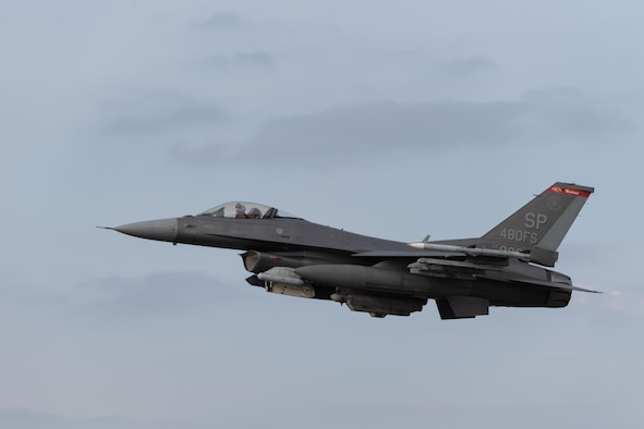 A U.S. Air Force F-16 Fighting Falcon aircraft from the 480th Fighter Squadron takes off during an Agile Combat Employment exercise at Ramstein Air Base, Germany, March 23, 2021. The exercise, which ran from March 22-26, featured jets flying two missions a day. (U.S. Air Force photo by Senior Airman John Wright.)