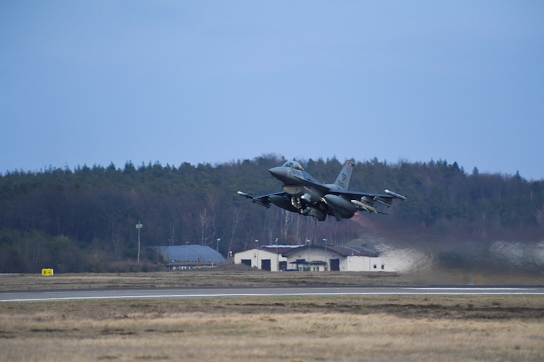 A U.S. Air Force F-16 Fighting Falcon aircraft from the 480th Fighter Squadron takes off during an Agile Combat Employment exercise at Ramstein Air Base, Germany, March 23, 2021. The exercise, which ran from March 22-26, featured jets flying two missions a day. (U.S. Air Force photo by Tech. Sgt. Warren D. Spearman Jr.)