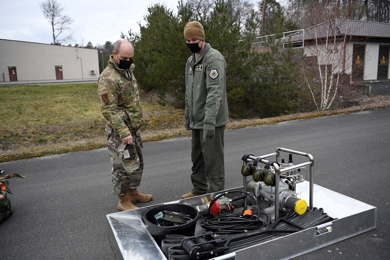 U.S. Air Force Col. David Epperson, 52nd Fighter Wing commander, shows the Viper Kit to U.S. Air Force Gen. Jeffery Harrigian, United States Air Forces in Europe and Air Forces Africa commander, during an Agile Combat Employment exercise at Ramstein Air Base, Germany, March 22, 2021. The Viper Kit is a small self-contained, portable, hot-pit-capable servicing platform that allows fuels Airmen to hot and cold pit refuel aircraft in austere locations. (U.S. Air Force photo by Tech. Sgt. Warren D. Spearman Jr.)