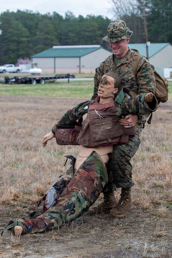 U.S. Marine Corps Capt. Matthew McGowan, an infantry officer with Headquarters Company, 6th Marine Regiment, 2d Marine Division, buddy drags a mannequin during a Division Leaders Assessment Program (DLAP) at Fort Pickett, V.A., March 28, 2021.