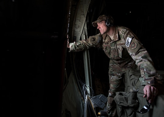 U.S. Air Force Master Sgt. Lief Christensen, 133rd Security Forces Squadron, Minnesota Air National Guard Phoenix Raven team leader, checks outside after landing in a C-130J Super Hercules at Kaedi Airfield, Mauritania, Feb. 22, 2020.