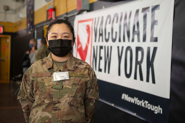 Senior Airman Can Liu, from Queens, N.Y., and a 335th Expeditionary Medical Operations Squadron general purpose Airman, pose for a photo at the state-led, federally-supported Medgar Evers College Community Vaccination Center in Brooklyn, N.Y., March 24, 2021. Liu, who is deployed from the 20th Civil Engineer Squadron out of Tyndall Air Force Base, Fla., was born in Fushun, China, is fluent in Mandarin, and moved to the U.S. with her family when she was nine years old. Liu is able to translate for Chinese community members who have questions while receiving their COVID-19 vaccination. (U.S. Air Force photo by Tech. Sgt. Ashley Nicole Taylor)