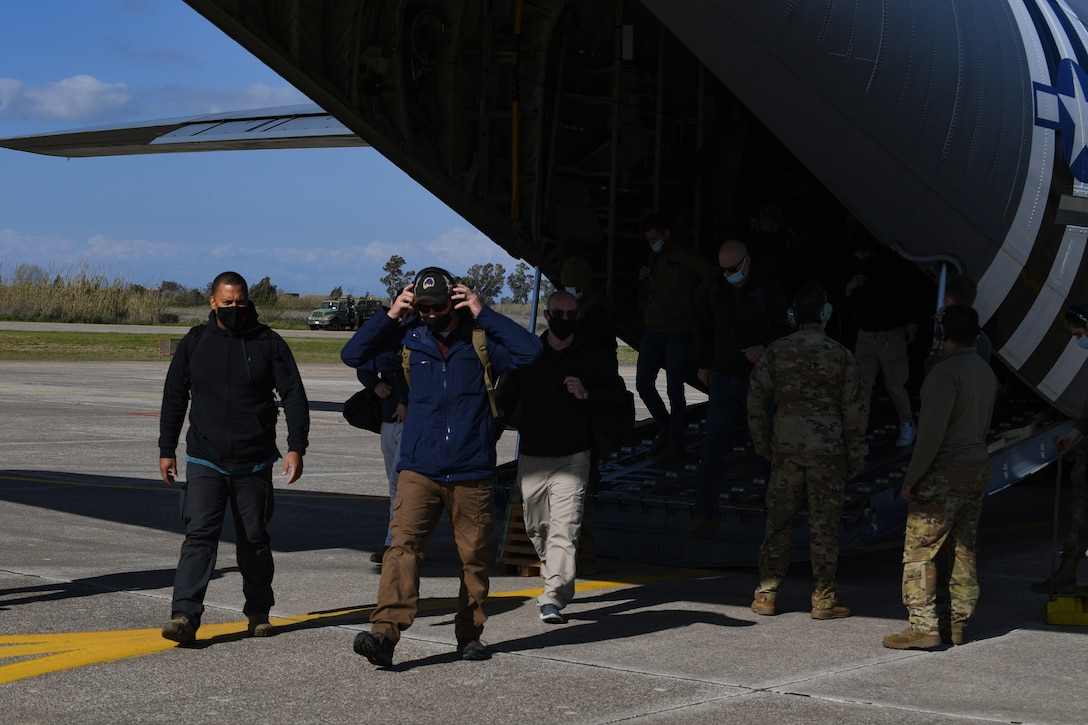 Members of the 31st Fighter Wing exit a U.S. Air Force C-130 Hercules at Andravida Air Base, Greece, April 6, 2021. The 31st FW arrived in Greece to participate in INIOCHOS 21. The U.S. Air Force has participated in INIOCHOS since 2017 and will provide Airmen, aircraft and equipment from the 31st FW this year. (U.S. Air Force photo by Airman 1st Class Thomas S. Keisler IV)