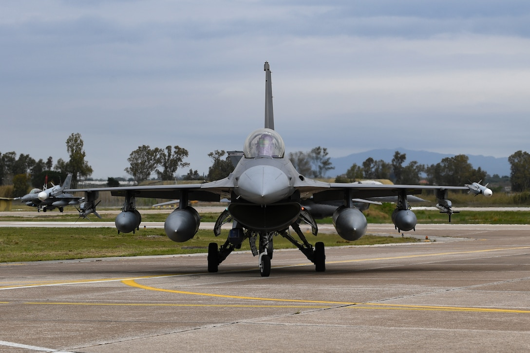 A U.S. Air Force F-16 Fighting Falcon from the 31st Fighter Wing taxis on the runway at Andravida Air Base, Greece, April 6, 2021. F-16s from the 31st FW arrived in Greece to participate in INIOCHOS 21, a Hellenic air force-led, large force flying exercise focused on strengthening partnerships and interoperability. (U.S. Air Force photo by Airman 1st Class Thomas S. Keisler IV)