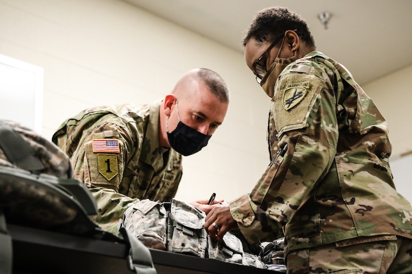 """U.S. Army Reserve 1st Sgt. James Upton, right, the first sergeant for Headquarters and Headquarters Company, U.S. Army Civil Affairs and Psychological Operations Command (Airborne), inspects the equipment of a Soldier participating in the in-processing portion of the 2021 USACAPOC (A) Best Warrior Competition at Fort Jackson, S.C. on April 6. Soldiers from across the nation traveled to compete in the 2021 USACAPOC (A) Best Warrior Competition, hosted from April 5-10, at Fort Jackson, S.C. The USACAPOC (A) BWC is an annual competition that brings in the best Soldiers across USACAPOC(A) to earn the title of """"Best Warrior"""" among their peers after being evaluated on their individual ability to adapt and overcome challenging scenarios and battle-focused events, testing their technical and tactical abilities under stress and extreme fatigue."""