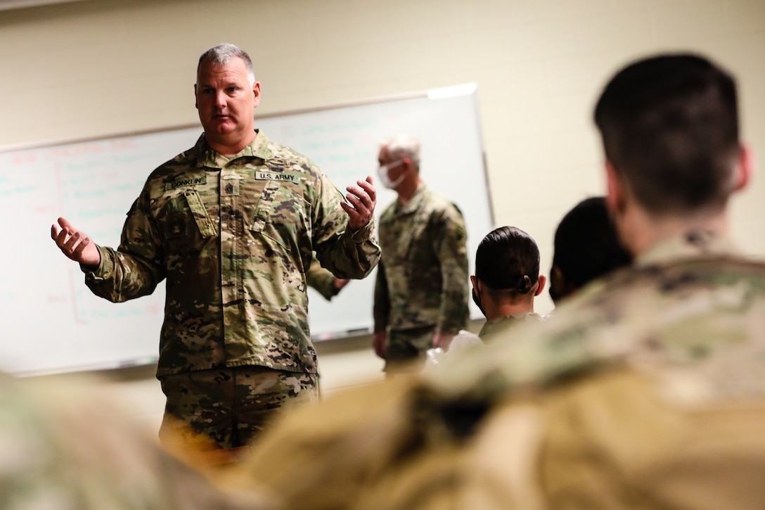 """Command Sgt. Maj. George Conklin, a senior enlisted advisor for the 354th Civil Affairs Brigade, U.S. Army Civil Affairs and Psychological Operations Command (Airborne), gives an introductory speech during the in-processing portion of the 2021 USACAPOC (A) Best Warrior Competition at Fort Jackson, S.C. on April 6. Soldiers from across the nation traveled to compete in the 2021 USACAPOC (A) Best Warrior Competition, hosted from April 5-10, at Fort Jackson, S.C. The USACAPOC(A) Best Warrior Competition is an annual competition that brings in the best Soldiers across USACAPOC(A) to earn the title of """"Best Warrior"""" among their peers after being evaluated on their individual ability to adapt and overcome challenging scenarios and battle-focused events, testing their technical and tactical abilities under stress and extreme fatigue."""