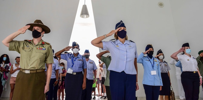 Australian Army Brigadier Nerolie McDonald, U.S. Indo-Pacific Command vice director for Intelligence, and U.S. Air Force Brig. Gen. Jennifer Short, Pacific Air Forces chief of staff, render salutes alongside a flight of multilateral Indo-Pacific partners during a visit to the U.S.S. Arizona Memorial, Honolulu, Hawaii, March 30, 2021. The memorial visit was organized as part of PACAF's first Women, Peace, and Security symposium, which enabled PACAF Airmen to work alongside partner nations to ensure the safety, security, and the protection of human rights among women and girls, especially during conflict and crisis.