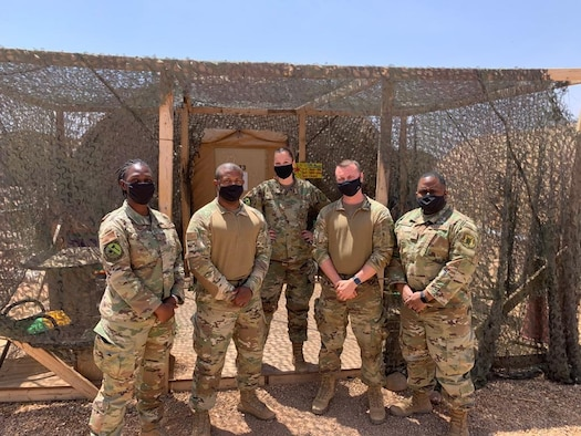 The 724th Expeditionary Air Base Squadron acquisition team poses for a photo at Nigerien Air Base 201, Agadez, Niger, April 6, 2021. The acquisition flight supports the AB 201 mission by providing full-range financial management assistance and being the acquisitions focal point for commodities, services and construction requirements. (Courtesy Photo)