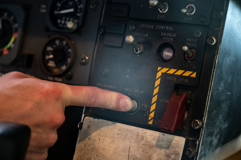 Tech. Sgt. Andrew Leaver pushes a button to retract the aircraft's drogue.