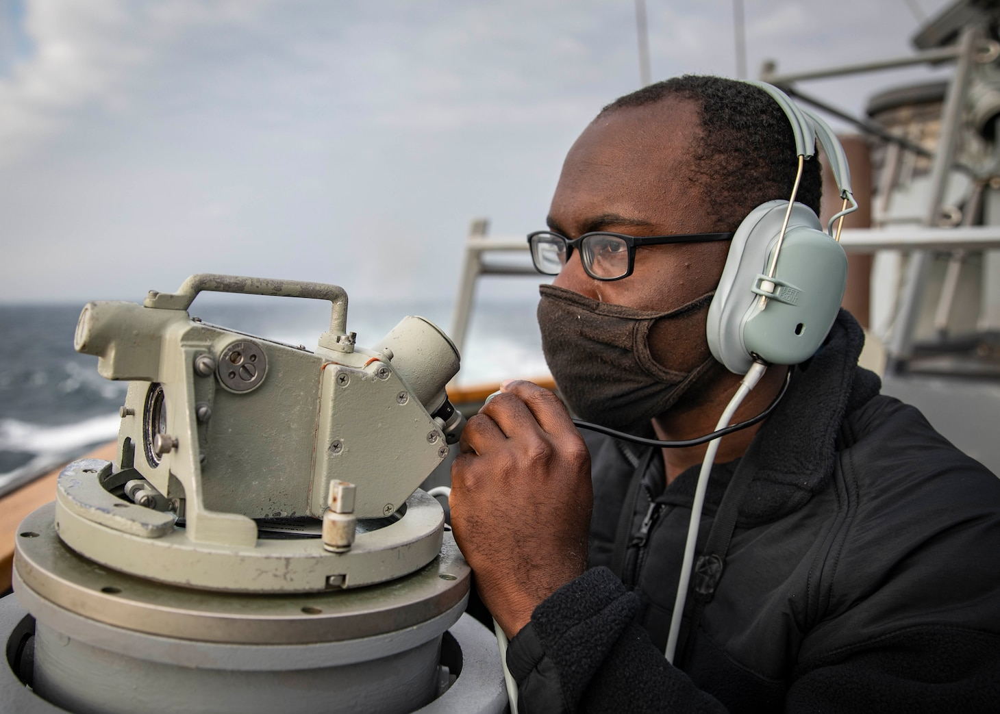 210407-N-HI376-1072 TAIWAN STRAIT (April 7, 2021) Seaman James Bailey, from Greenville, S.C., stands watch on the bridge of the Arleigh Burke-class guided-missile destroyer USS John S. McCain (DDG 56) during routine underway operations. John S. McCain is forward-deployed to the U.S. 7th Fleet area of operations in support of a free and open Indo-Pacific. (U.S. Navy photo by Mass Communication Specialist 1st Class Jeremy Graham)