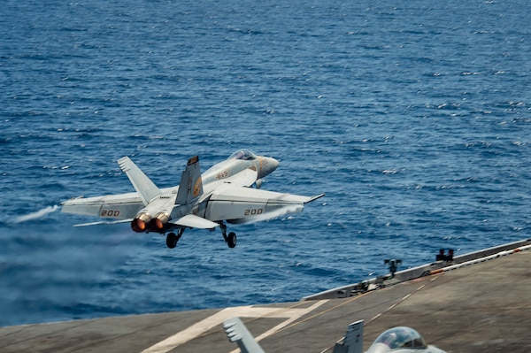 """An F/A-18E Super Hornet, assigned to the """"Tomcatters"""" of Strike Fighter Squadron (VFA) 31, launches from the flight deck of the aircraft carrier USS Theodore Roosevelt (CVN 71)."""