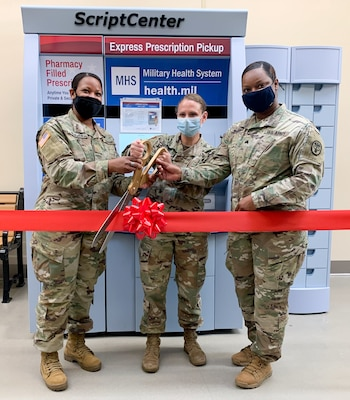 Tuttle Army Health Center Commander, Col. Tracy Ostrom (Center) helps cut the ribbon to Hunter Army Airfield's new ScriptCenter at the Hunter PX, March 31, assisted by Tuttle Deputy Commander for Nursing Maj. Edris Newman (Left) and Sgt. Annastaycha Butler, NCOIC of Tuttle Pharmacy.