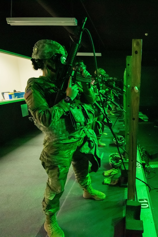 811th Hospital Center Soldiers complete M9 and M4 simulations training on Engagement Skills Trainer