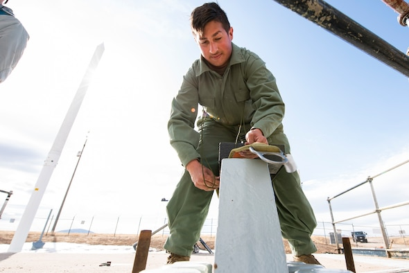 Airman 1st Class Emilio Gilliam, 341st Missile Maintenance Squadron missile maintenance trainee, performs topside maintenance of a launch facility March 27, 2021, near Malmstrom Air Force Base, Mont.