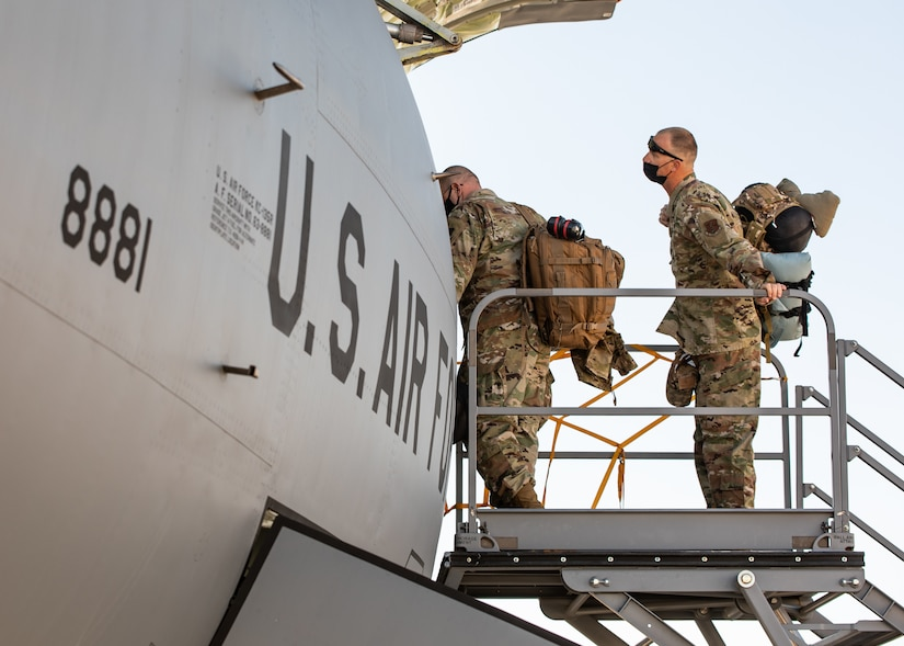 Airmen loading into airplane