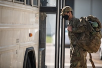 Airman loading onto bus.