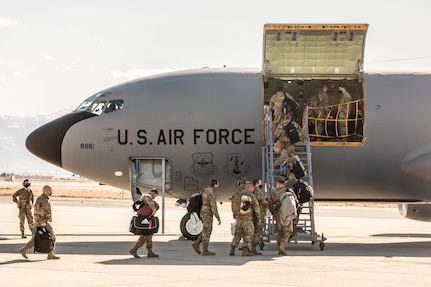 Airmen loading into airplane.