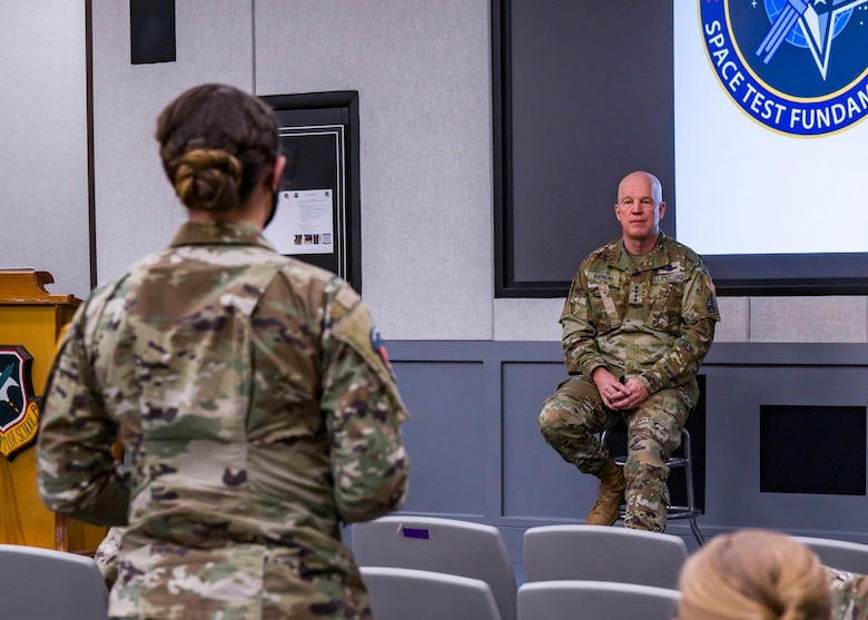 "United States Space Force Gen. John W. ""Jay"" Raymond, Chief of Space Operations, responds to a question from Spc. 4 Haley Roll, Space Test Fundamentals Class 21-1 student, at Edwards Air Force Base, California, April 6. (Air Force photo by Giancarlo Casem)"