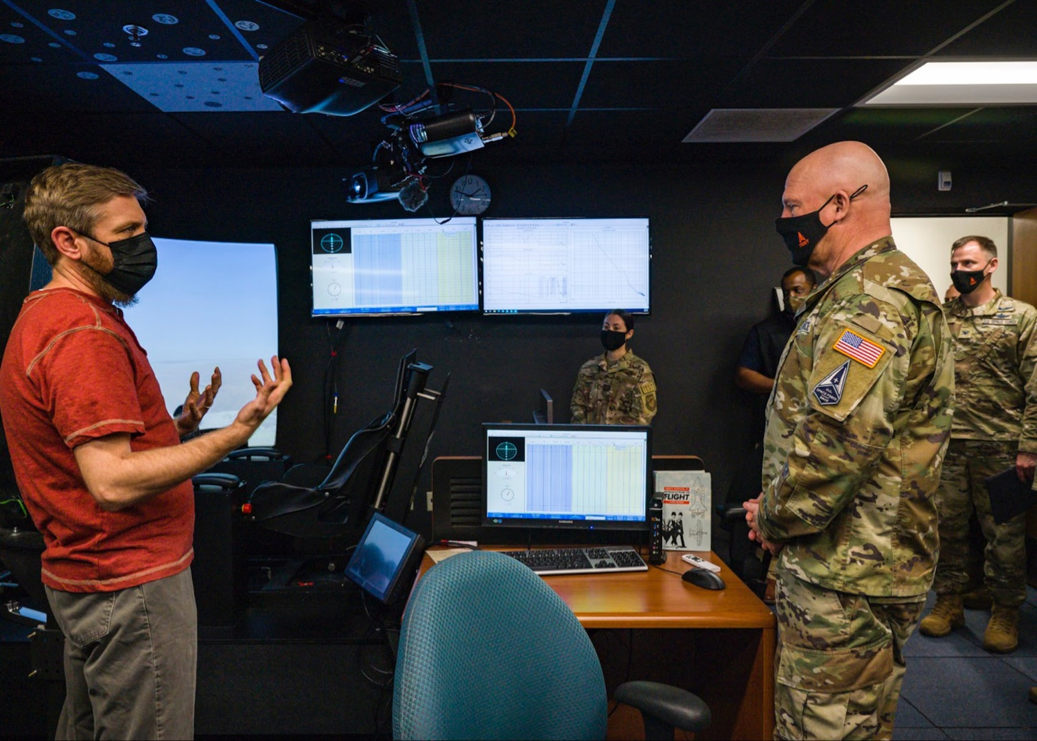 """United States Space Force Gen. John W. """"Jay"""" Raymond, Chief of Space Operations, receives a tour of a flight simulator at the Air Force Test Pilot School at Edwards Air Force Base, California, April 6. (Air Force photo by Giancarlo Casem)"""