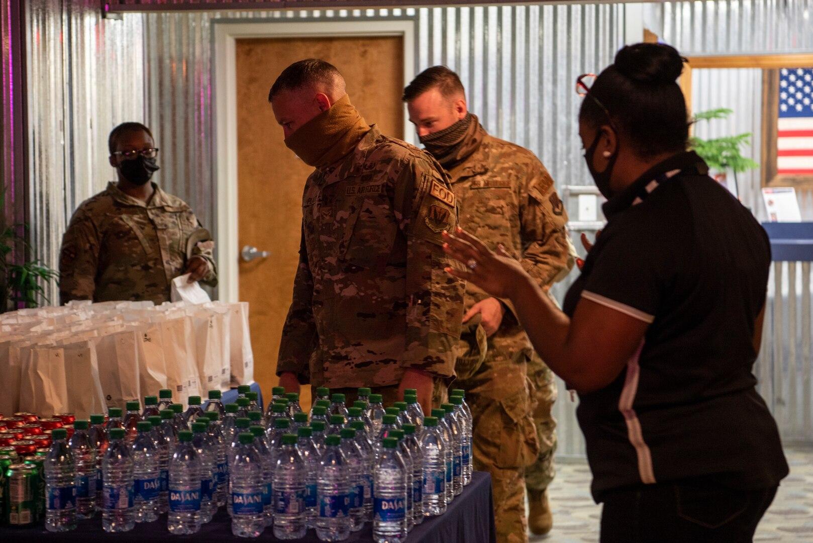 Airmen attend the USO of North Carolina's reopening at Seymour Johnson Air Force Base, North Carolina, April 01, 2021.