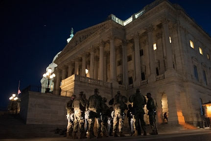 Soldiers with the New Jersey Army National Guard's A Troop and Headquarters Troop, 1st Squadron, 102nd Cavalry Division, and U.S. Capitol Police officers confer with each other hours after a vehicle rammed a barricade killing one Capitol Police officer and injuring another one at the U.S. Capitol April 2, 2021. The New Jersey Army Guard unit is one of several that continue to support the security mission at the Capitol — made possible by the synchronization efforts involving the National Guard Bureau, the District of Columbia National Guard and Guard units from 11 states.