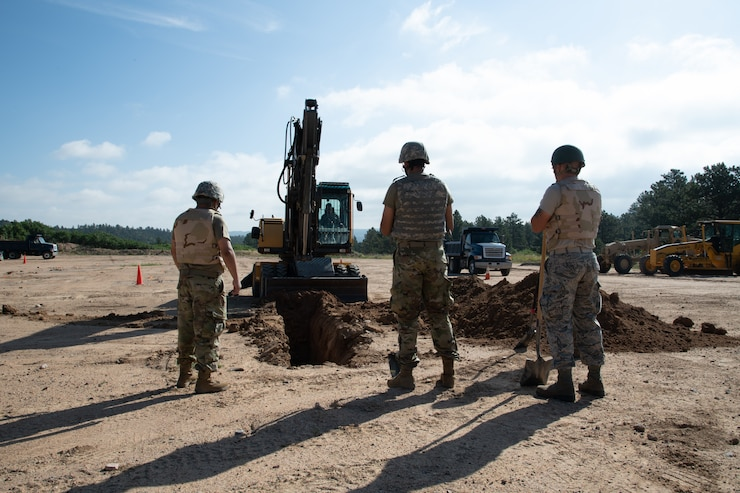 Reservists from the 302nd Civil Engineer Squadron excavate a site in preparation for burying a pipe on the U.S. Air Force Academy, Colorado