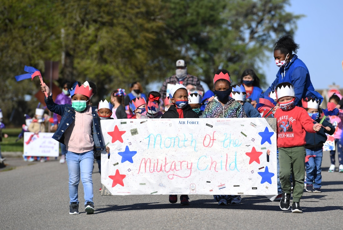 Children of Keesler personnel participate during a parade in front of the child development center at Keesler Air Force Base, Mississippi, April 1, 2021. The event was held in celebration of the Month of the Military Child, which is recognized throughout the month of April. (U.S. Air Force photo by Kemberly Groue)