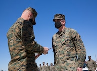 U.S. Marine Corps Lieutenant Colonel Nicholas Lozar reads award warrant for U.S. Navy Hospital Corpsman Third Class (HM3) Randall Lambert at Cannon Air Defense Complex in Yuma Ariz. Mar 5 2021. The Navy and Marine Achievement Medal is awarded for superior performance of a service member's duties. ( U.S. Marine Corps photo by Lance Cpl. Matthew Romonoyske-Bean)