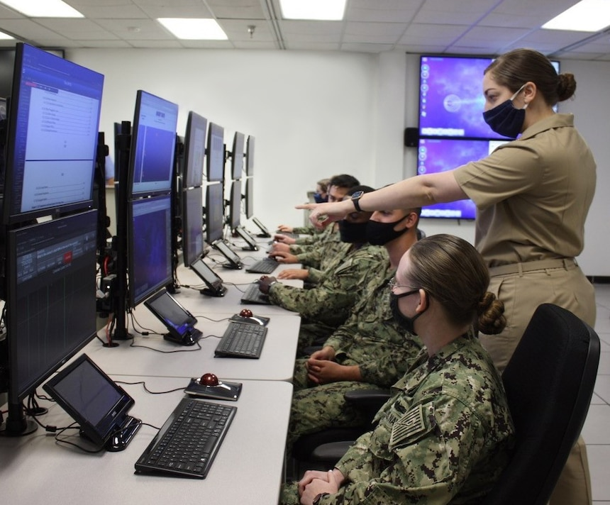 SAN DIEGO (March 11, 2021) Sailors from the Center for Surface Combat Systems' (CSCS) Fleet Anti-Submarine Warfare Training Center (FASW) are accessing learning games and sandbox tools in the newly installed AN/SQQ-89A(V)15 Virtual Operator Trainer (VOT).  Four VOTs were delivered at FASW by the Program Executive Office Integrated Warfare Systems 5.0 (PEO IWS 5.0) and funded by Director, Surface Warfare's (OPNAV N96) program of record, Surface Training Advanced Virtual Environment-Combat Systems (STAVE-CS), to provide better quality training for Sailors and Officers.  By Fiscal Year 23, VOTs will be installed in seven fleet concentration areas.  (U.S. Navy photo by Lt. Samantha Drumb)