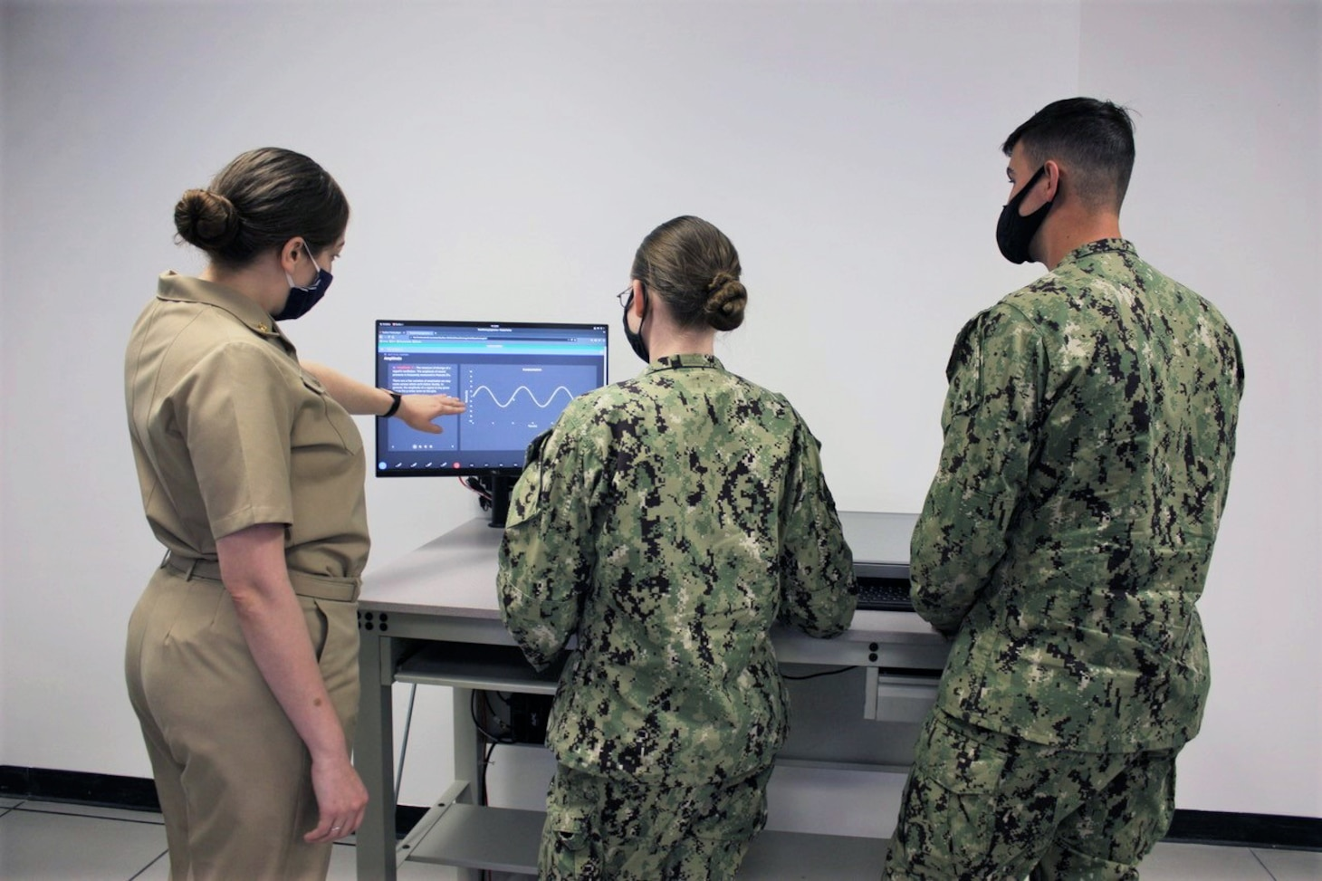SAN DIEGO (March 11, 2021) Sailors from the Center for Surface Combat Systems' (CSCS) Fleet Anti-Submarine Warfare Training Center (FASW) are operating the dual display station (DDS) workstation, a unique feature of the AN/SQQ-89A(V)15 Virtual Operator Trainer (VOT) that provides geographic plotting capability to aid in gaining situational awareness and conduct undersea warfare fire control solution development.  The workstation was designed to be a commercial-equivalent representation of the DDS installed aboard Arleigh Burke-class guided missile destroyers and Ticonderoga-class guided-missile cruisers in the combat information center. (U.S. Navy photo by Lt. Samantha Drumb)