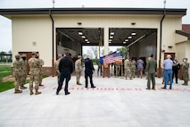 Base personnel gather outside Fire Station Two for a ribbon cutting ceremony at Barksdale Air Force Base, Louisiana, April 7, 2021.