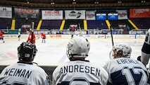 Master Sgt. Jonathan Weiman, Lt. Col. Scott Andresen, and Lt. Col. Scott Eberle, Barksdale Bombers hockey team members, watch as their team competes at Hirsch Memorial Coliseum in Shreveport, Louisiana, March 31, 2021.