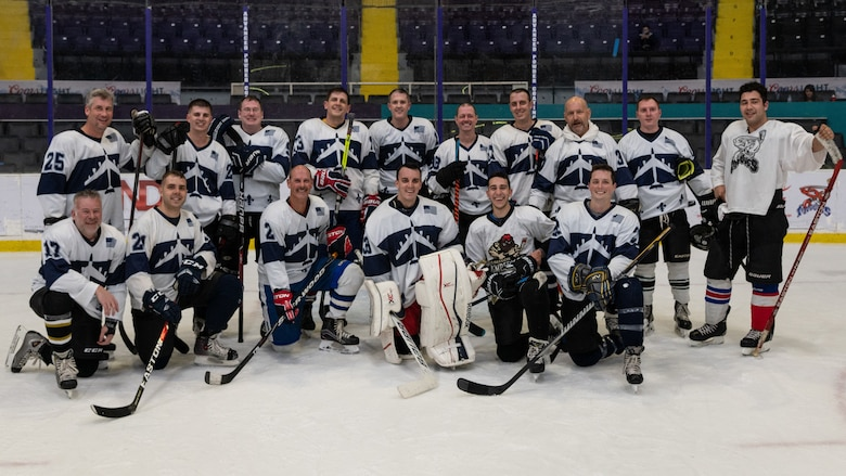 The Barksdale Bombers hockey team from Barksdale Air Force Base, Louisiana, pose for a group photo in the Hirsch Memorial Coliseum at Shreveport, Louisiana, March 31, 2021.