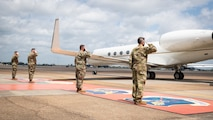 Leaders from the 2nd Bomb Wing and Air Force Global Strike Command salute the departure of Honorable John P. Roth, acting Secretary of the Air Force, at Barksdale Air Force Base, Louisiana, April 6, 2021.